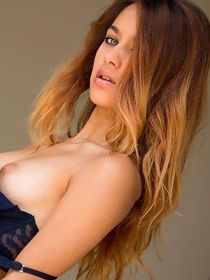 Uma Jolie slips off her...