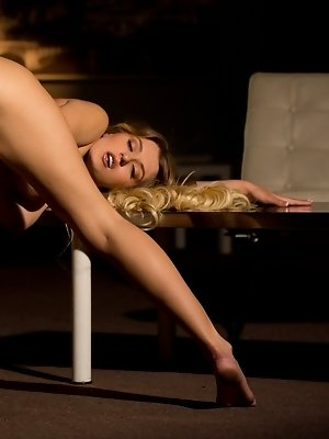 Natalia Starr undresses on...