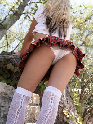 School girl in plaid red...
